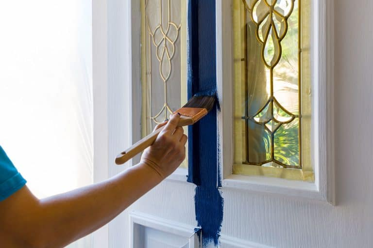 A man painting the door with blue oil based paint, What Kind Of Paint Should I Use On A Fiberglass Door?