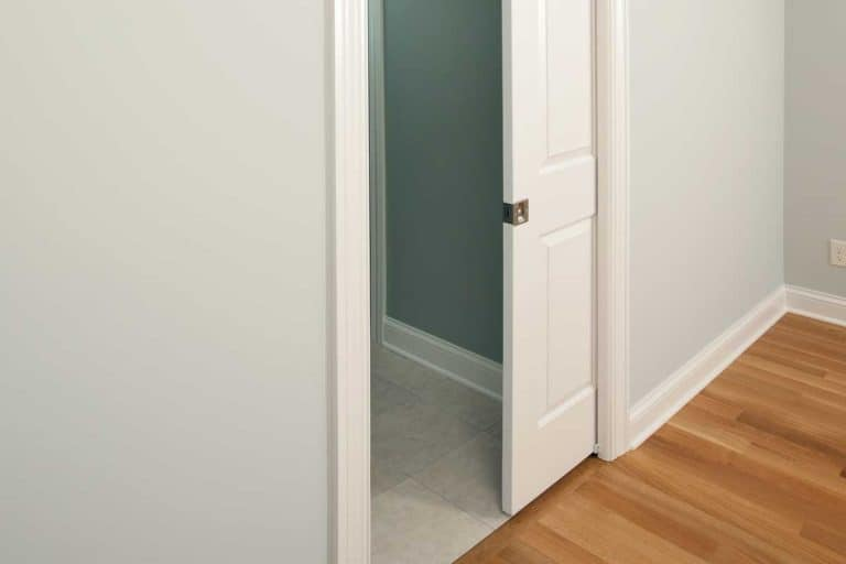A new pocket door in a house bedroom entrance to bathroom, Are Pocket Doors Good For Bathrooms?