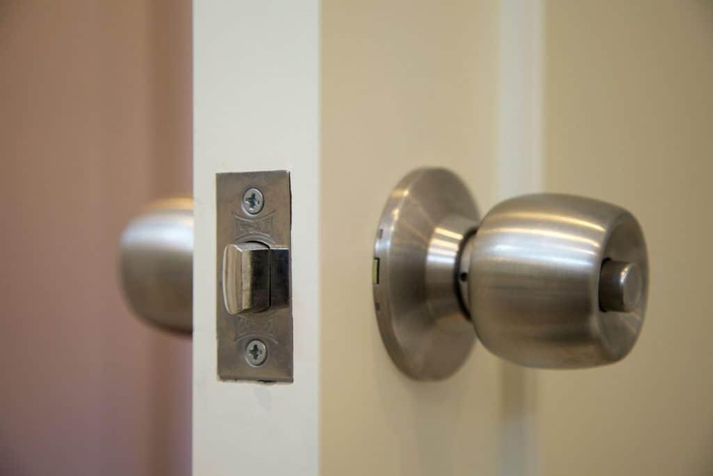 A stainless steel door knob installed in the front door