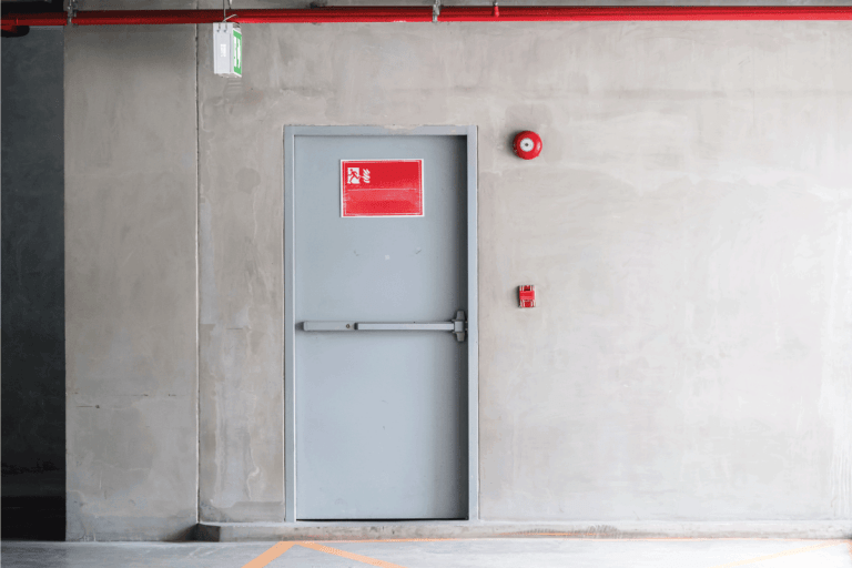 Fire exit door for emergency case of the parking building near the business office. Do Fiberglass Doors Rot Or Rust Over Time