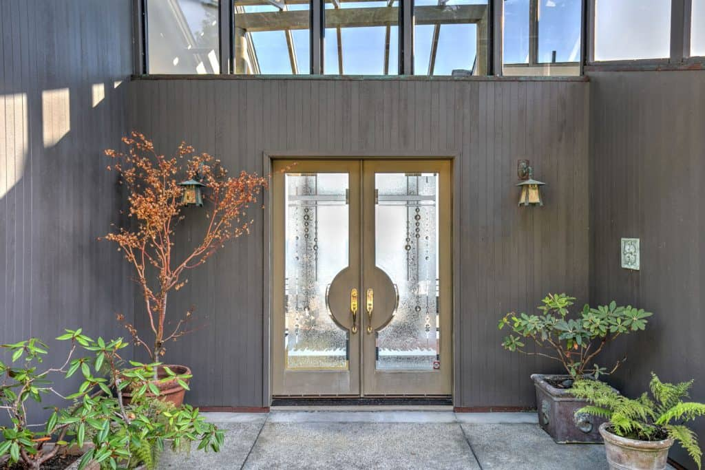 Interior of a contemporary entryway with a French fiberglass door