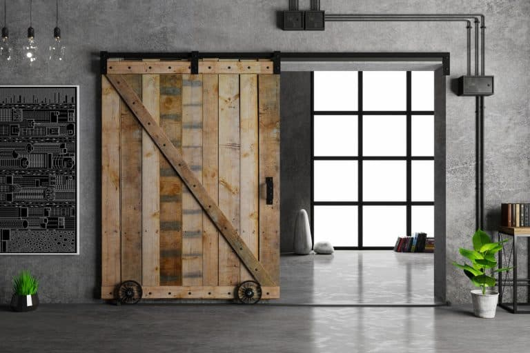 Modern interior in loft style barn sliding wooden door in loft room, Can You Lock A Barn Door From Both Sides?