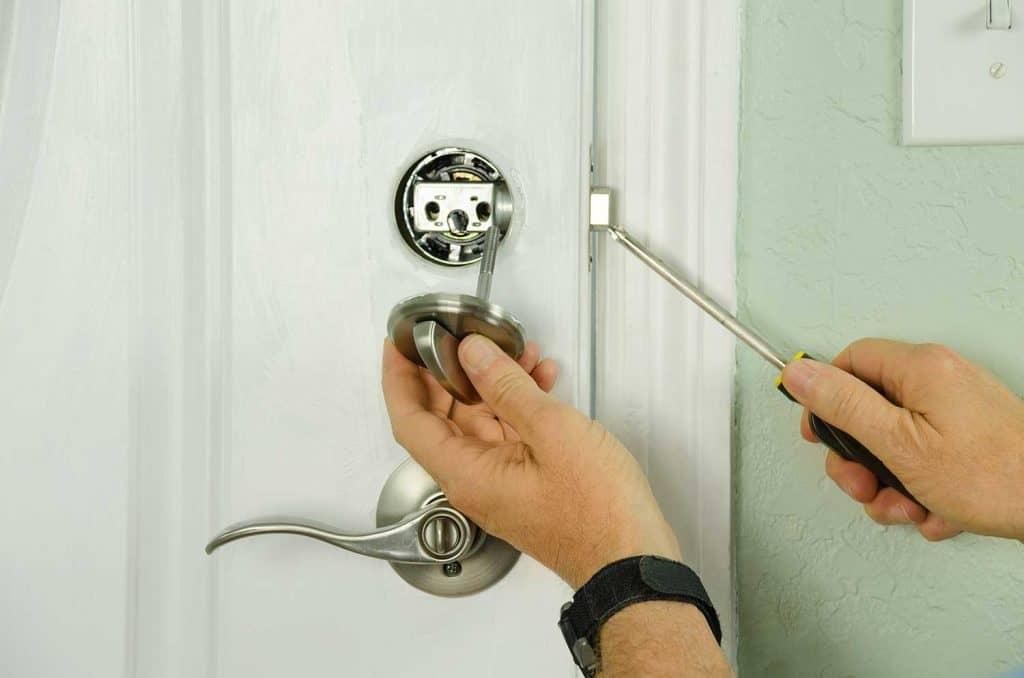 Repairing installing door deadbolt lock on house