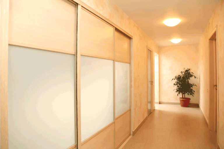 The spacious bright corridor with pocket doors on the side. Do Pocket Doors Require Thicker Walls