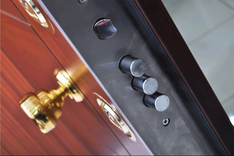 modern steel front door with painted wooden design in front. Steel Vs Fiberglass Door - Which Is Better For You