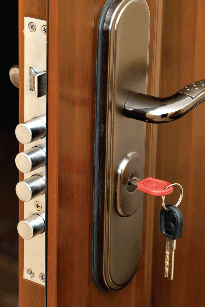 mortise lock with keys installed in a wooden door