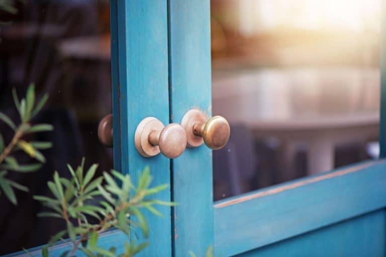 A blue painted double door with two dummy door knobs, How To Install A Dummy Door Knob