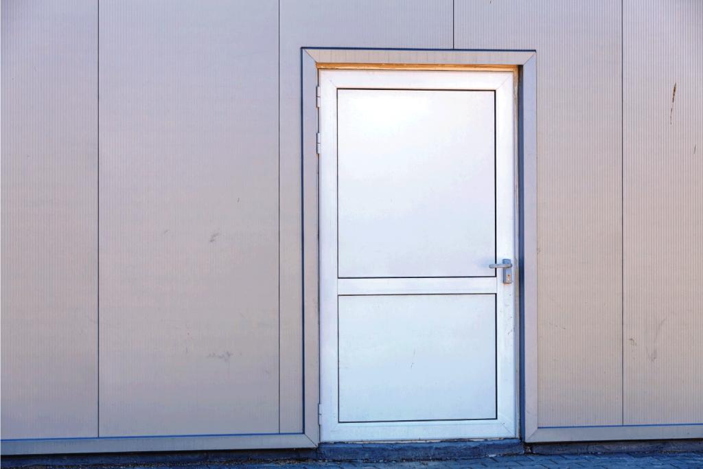 Aluminum facade on industrial building with steel door