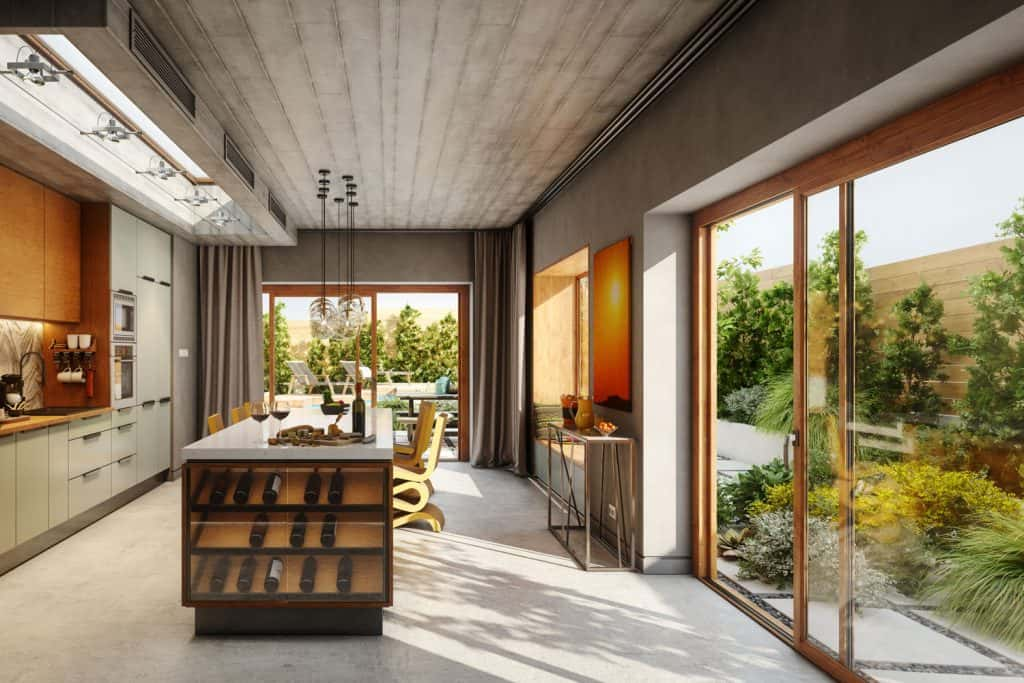 An ultra modern and luxurious kitchen with huge sliding doors and gorgeous landscaping