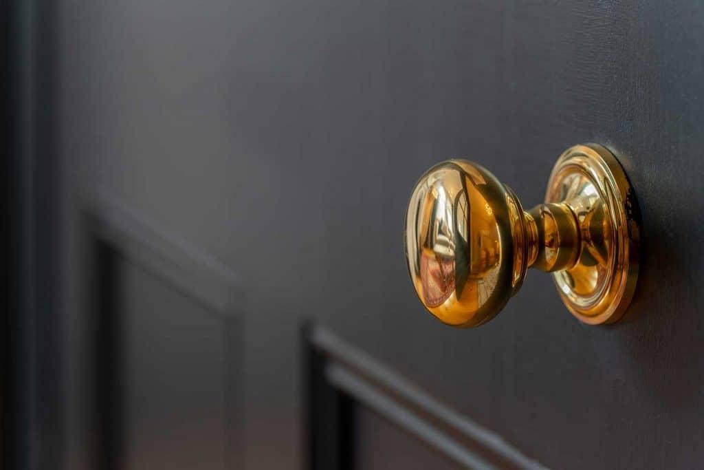 Brass door knob and wooden door