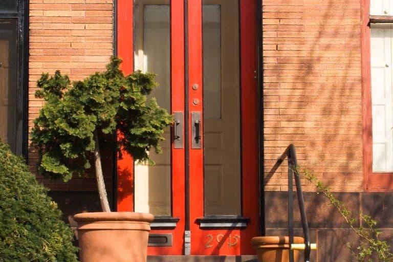 Brightly painted red front door, Should Your Screen Door Match The Front Door?