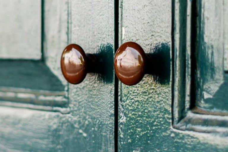 Close up of a green french door with dummy door knobs, Do Dummy Door Knobs Turn?