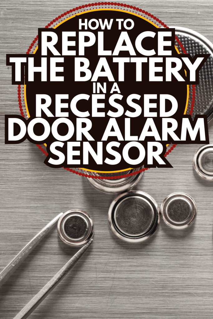 Closeup button cell battery picked up using tweezers. How To Replace The Battery In A Recessed Door Alarm Sensor