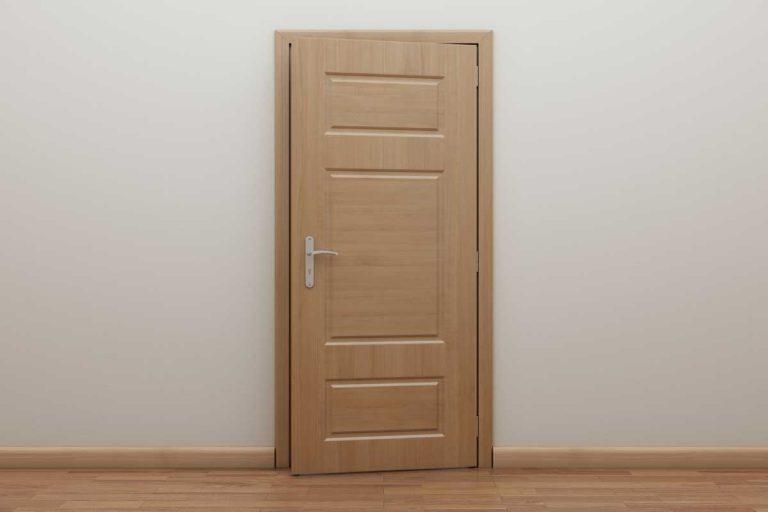 Empty room with wooden oak door, What Color Floor Goes With Oak Doors?