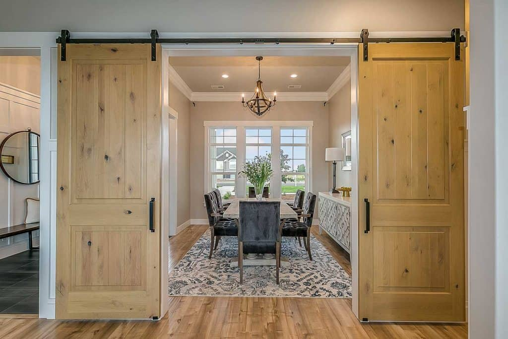 Exquisite dining room with double barn door entrance
