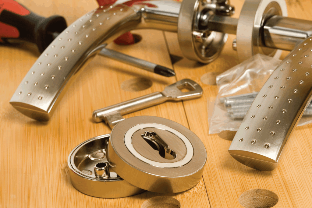 Interior door handle being assembled on a wooden table