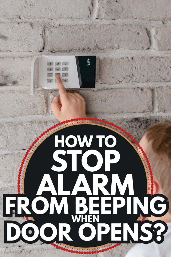Little baby boy pushes a buttons on the alarm keypad. How To Stop Alarm From Beeping When Door Opens