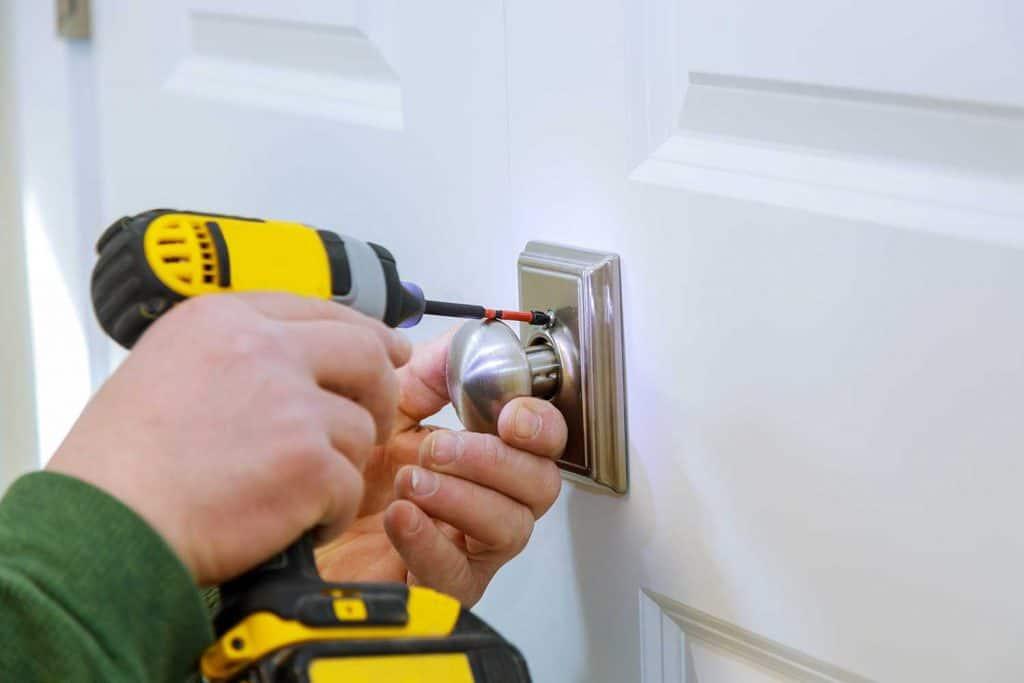 Locksmith install the door new dummy lock in house