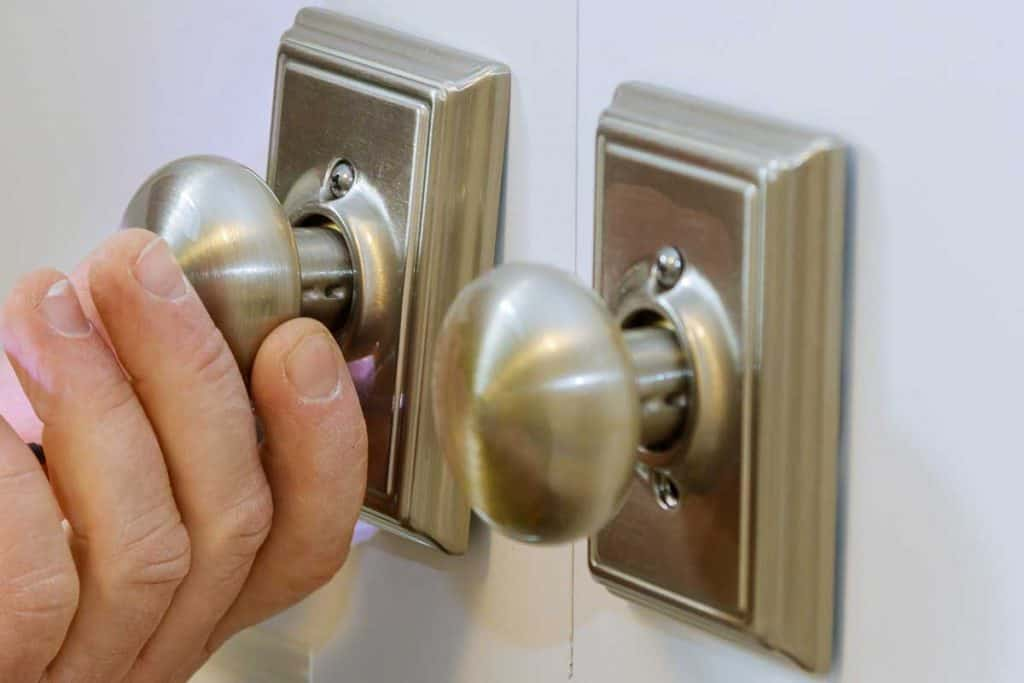 Locksmith worker installing a new dummy lock in house on door, Where To Use Dummy Door Knobs