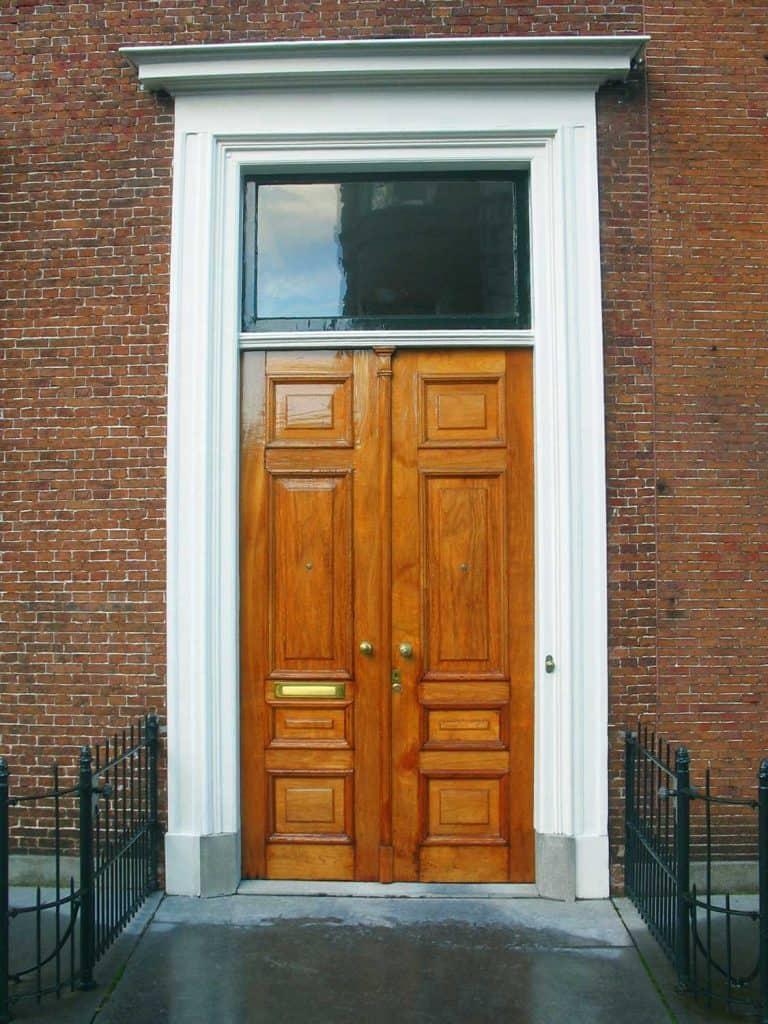 Two closed wooden oak business doors