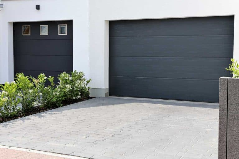 Two modern new garage doors in a residential district, Do Garage Doors Come With Tracks?