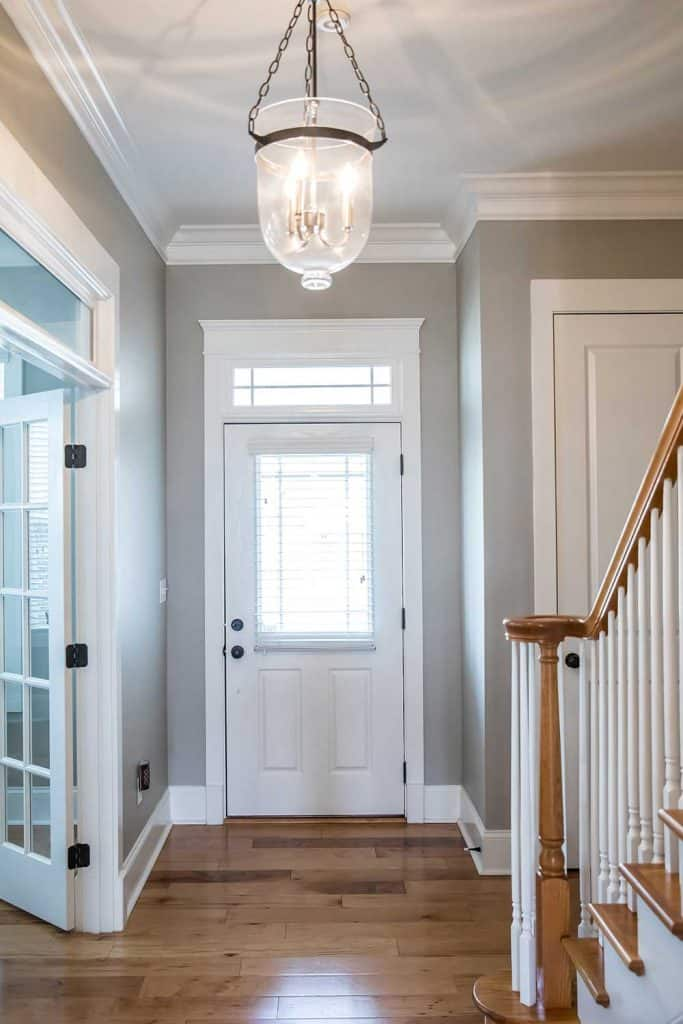 View of the interior front door from a hallway corridor entrance of a new construction house