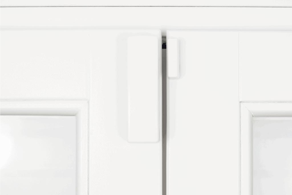 wireless battery magnetic alarm sensor for window and door on white wooden double door
