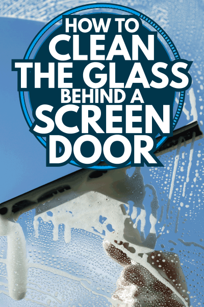 clear blue sky behind a glass being cleaned using squegee. How To Clean The Glass Behind A Screen Door