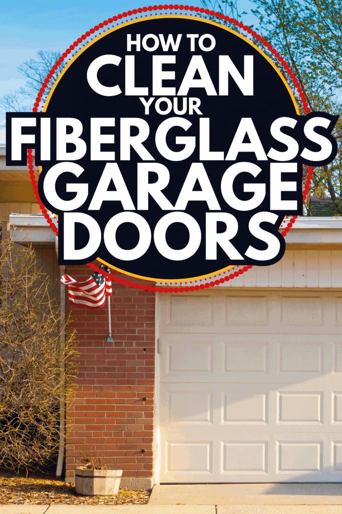 garage door of a brick wall house. How to Clean Your Fiberglass Garage Doors