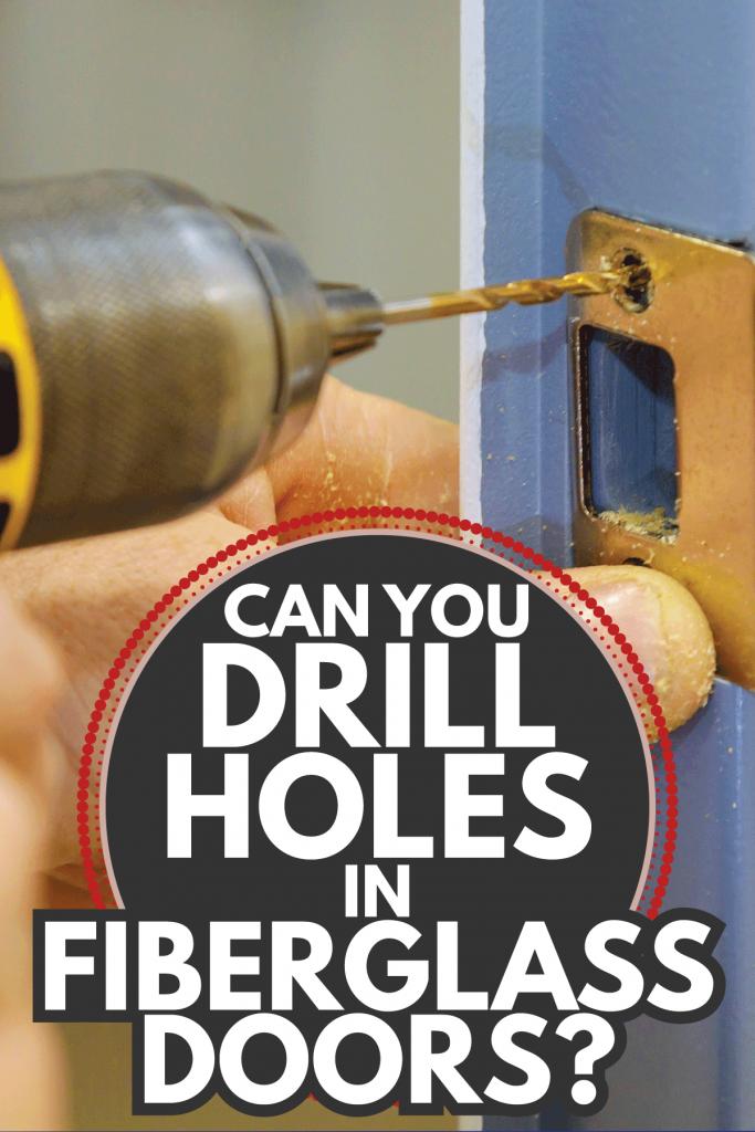 installing worker hands new door locker in the door lock. Can You Drill Holes In Fiberglass Doors