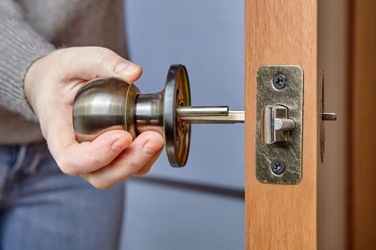 A locksmith removing a doorknob for a few adjustments, How To Remove A Door Knob From The Outside
