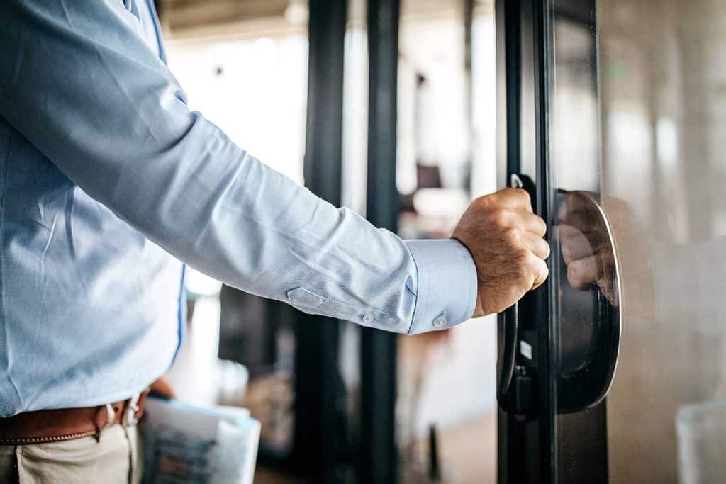 Businessman opening door entering office cabin