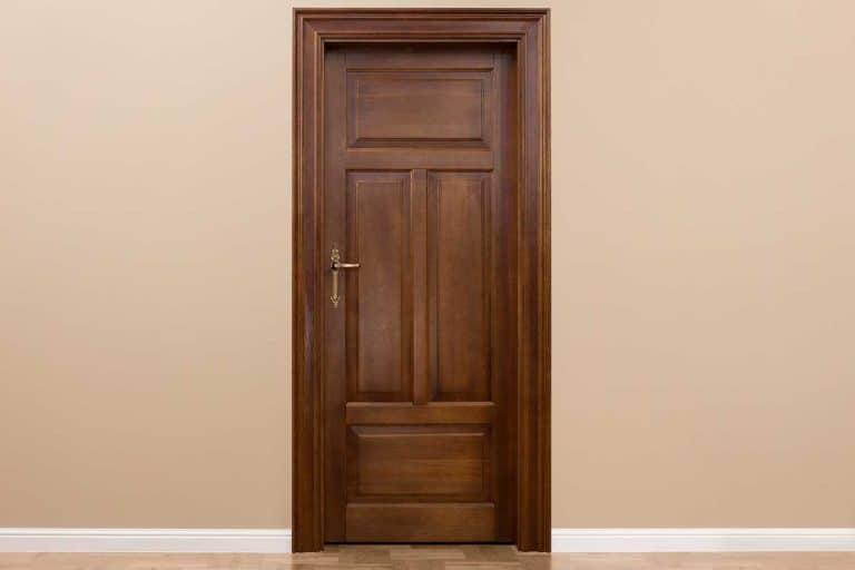 Close up of wooden door in the empty room, Should You Varnish Oak Doors?