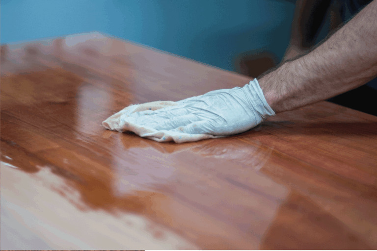 Finishing a timber door by hand with oil or wax. French polishing wooden furniture with a rag to achieve a shiny, flawless surface. How To Oil Or Wax An Oak Door