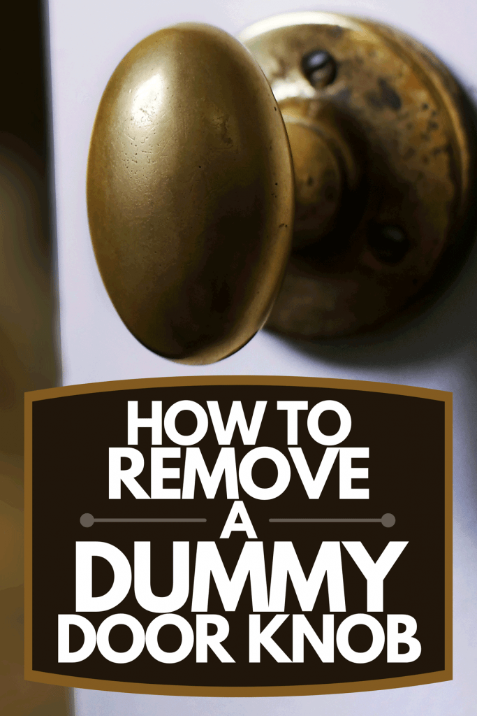 Slightly open door with an old brass handle leading into a dark domestic living room with a floor lamp, How To Remove A Dummy Door Knob