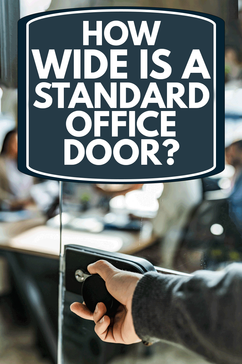 Close up of unrecognizable male person opening glass door to enter the office, How Wide Is A Standard Office Door?