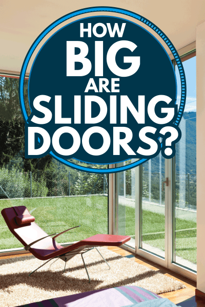 Modern house interior with reclining chair facing outside the big sliding door. How Big Are Sliding Doors
