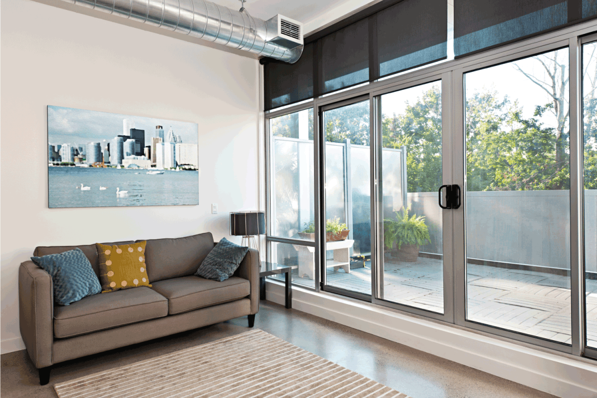 Modern living room and balcony with big sliding doors