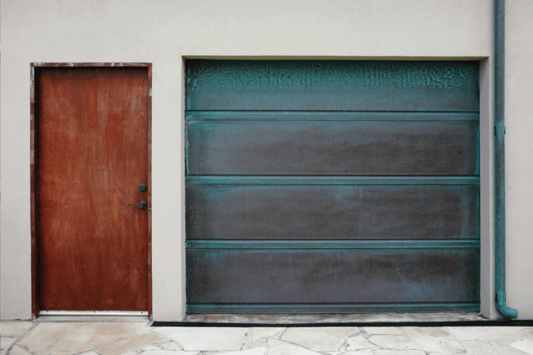 Straight forward shot of garage door and entry to a Hawaiian beach house. Weathered look due to salty air. Do Garage Doors Have A Soft Side