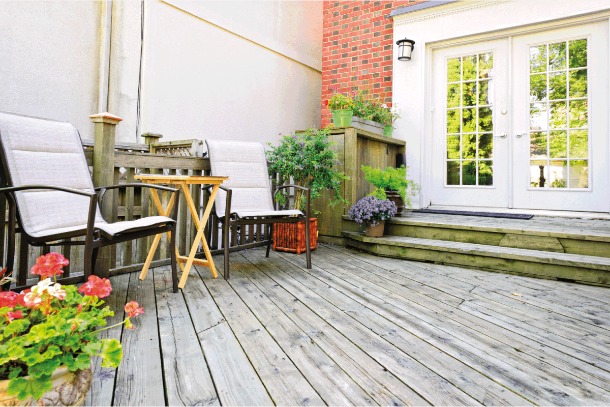 Wooden deck at home with french patio doors at the back