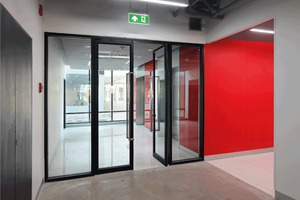glass double door with exit sign above. How To Install Magnetic Lock On A Glass Door
