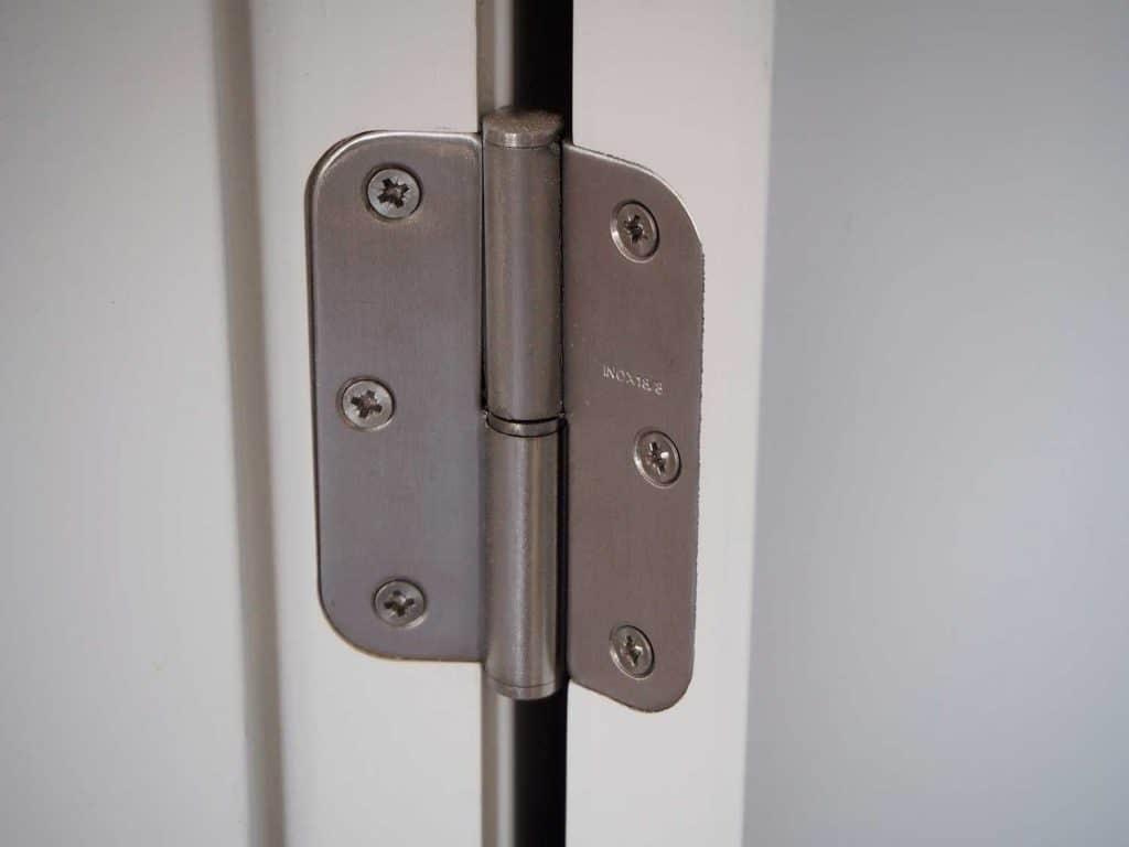 A hinge in the white door