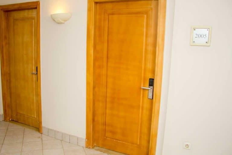An empty hall with closed doors, How To Cut A Veneer Door