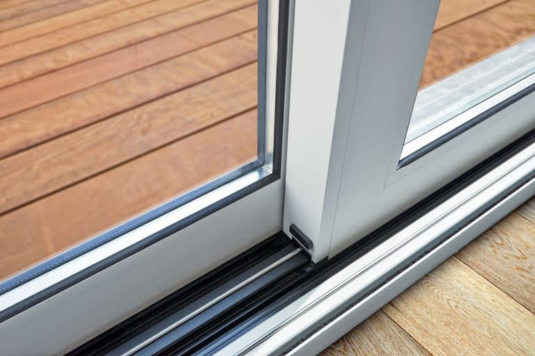 An up close photo of a sliding doors mechanism, Sliding Door Keeps Coming Off Track - What To Do?