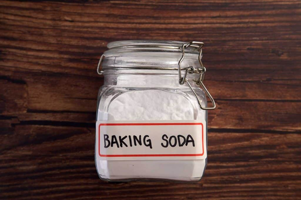 Baking soda on the wooden background