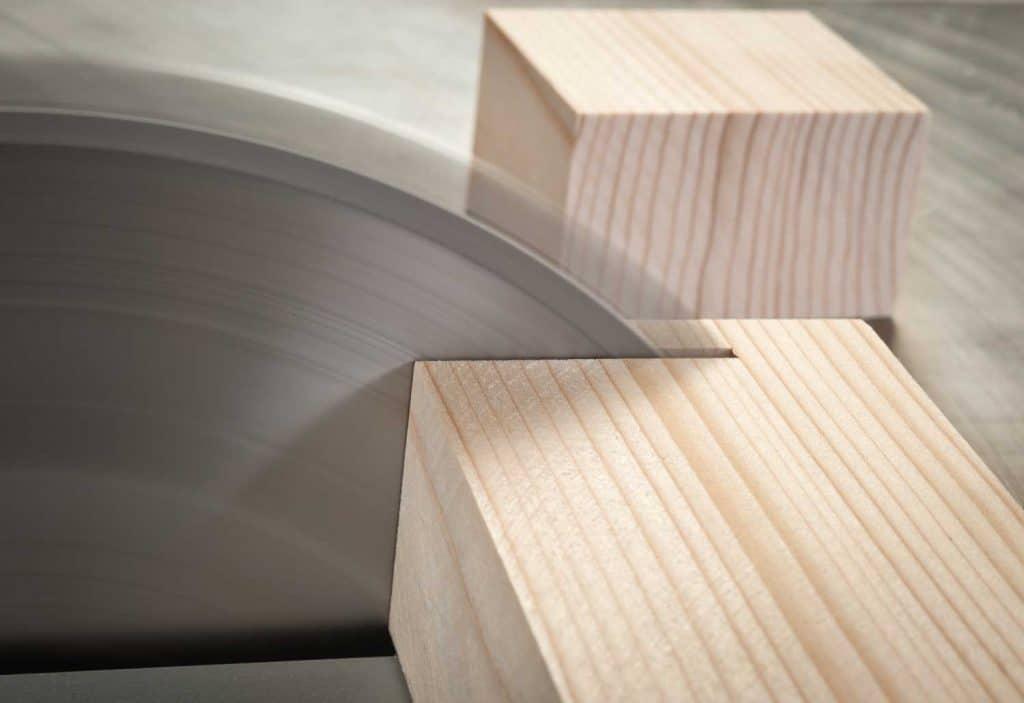 Circular saw cutting wooden plank