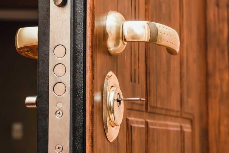 Golden handle, lock with the key of a brown front door, Can Passage Door Knobs Be Used On Exterior Doors?