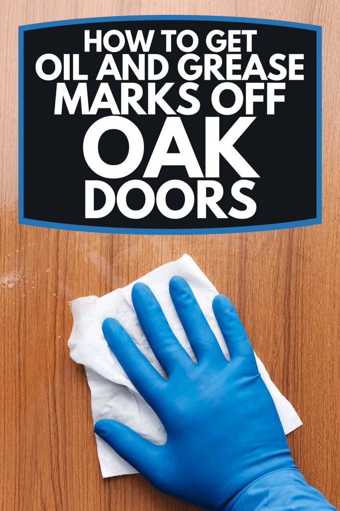 A hand wearing blue glove wiping oak door, How To Get Oil And Grease Marks Off Oak Doors
