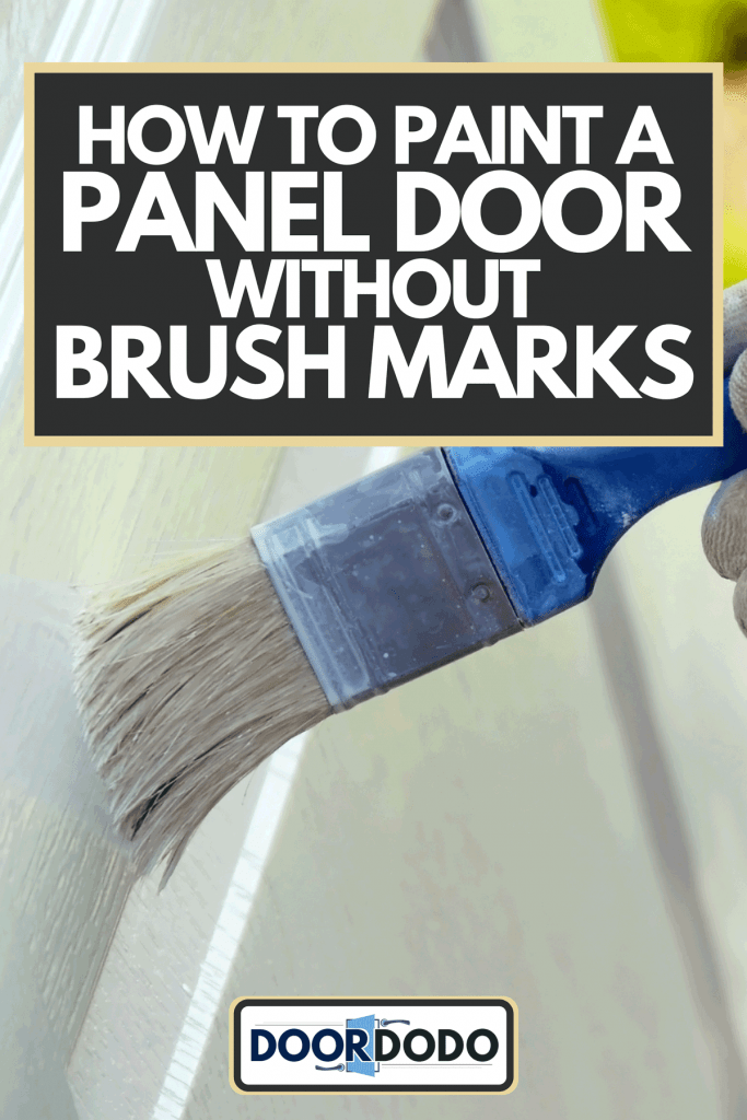 A brush in hand painting white wooden surface, How To Paint A Panel Door Without Brush Marks