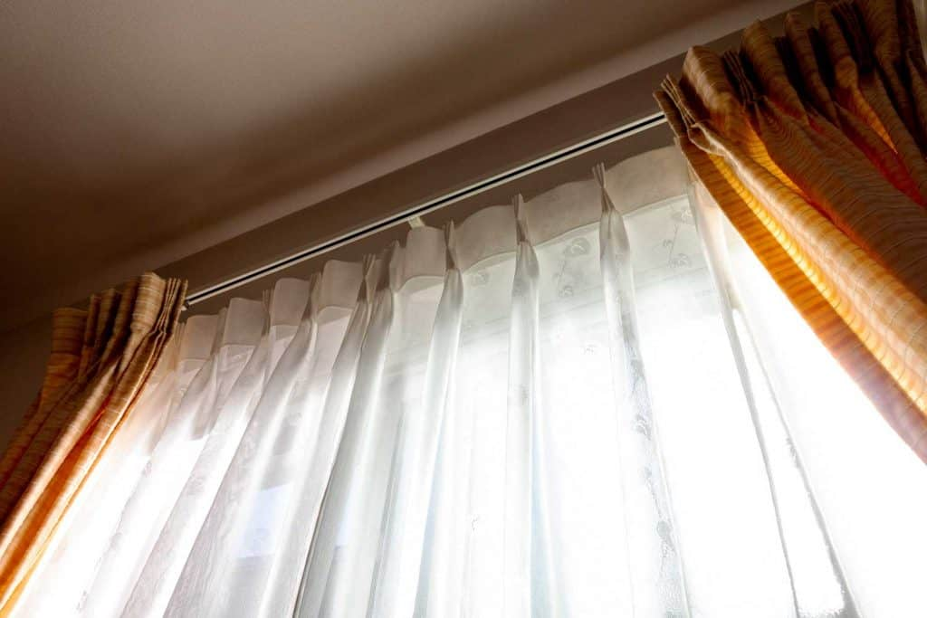 Sunlight into the room through lace fabric curtain